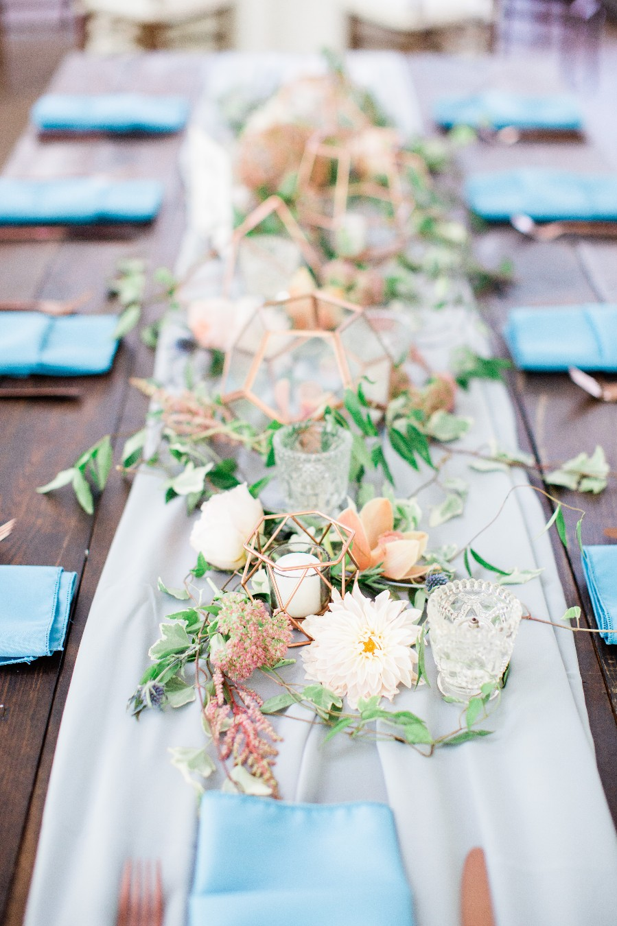 Dusty blue, copper, peach garden wedding with farm tables