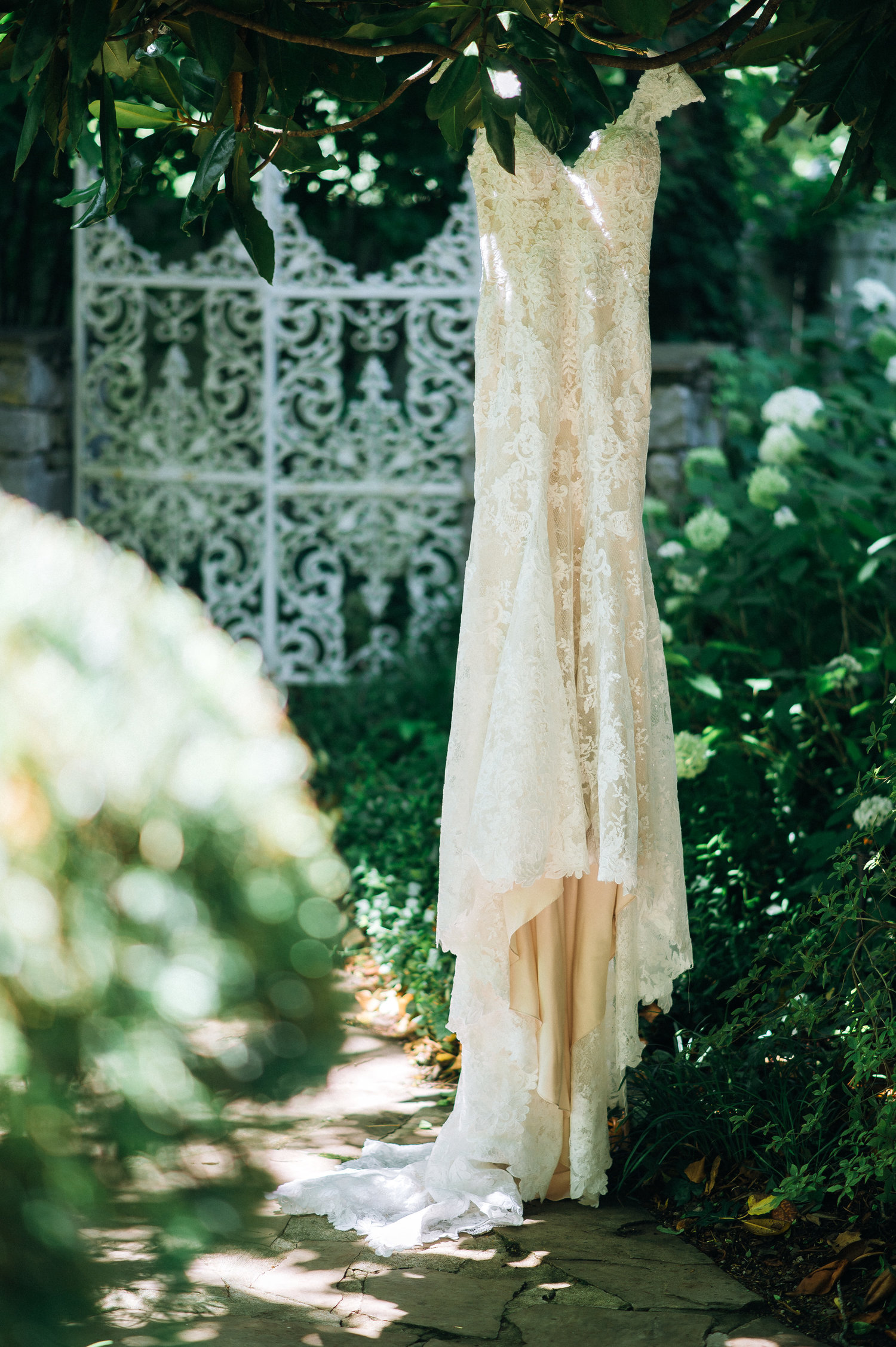 Lace trumpet wedding gown at garden wedding venue in Nashville