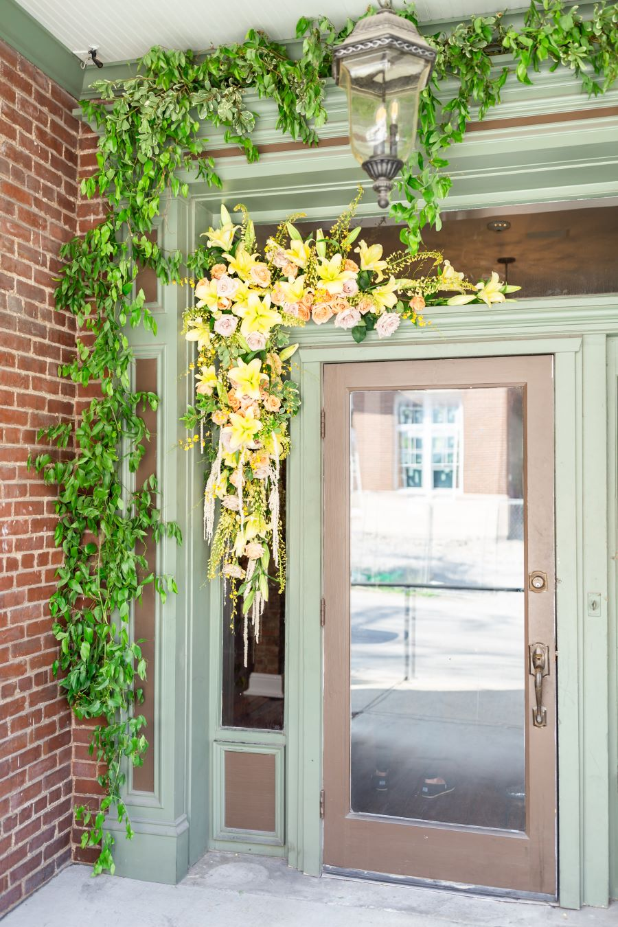 Floral arrangement garnishing door as welcome to McConnell House for tasting party / Whimsical / Summer / August / Yellow / Lavender / Blush