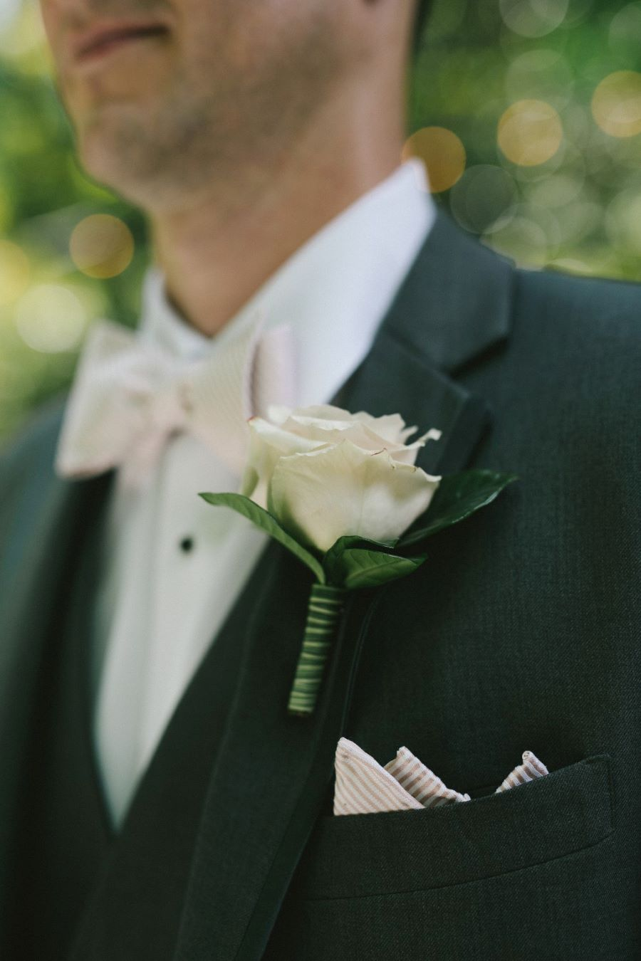 Close up of groom's tux with bow tie and boutonniere / Classic / Vintage / Spring / May / Blush / Cream