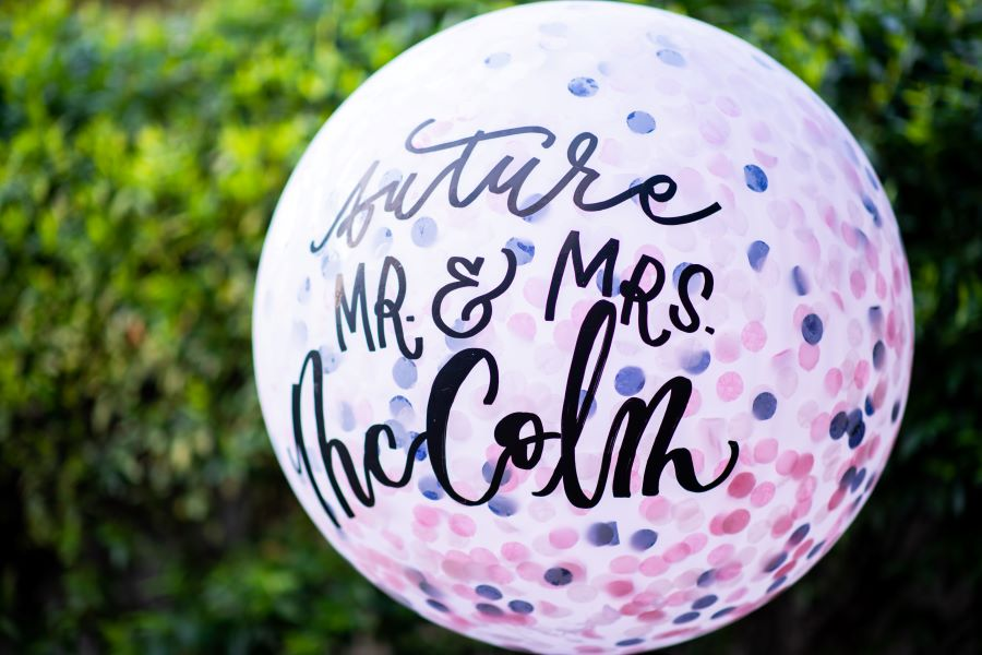 Future bride and groom names written on giant balloon in script /Traditional / Summer / June / Navy / Blush