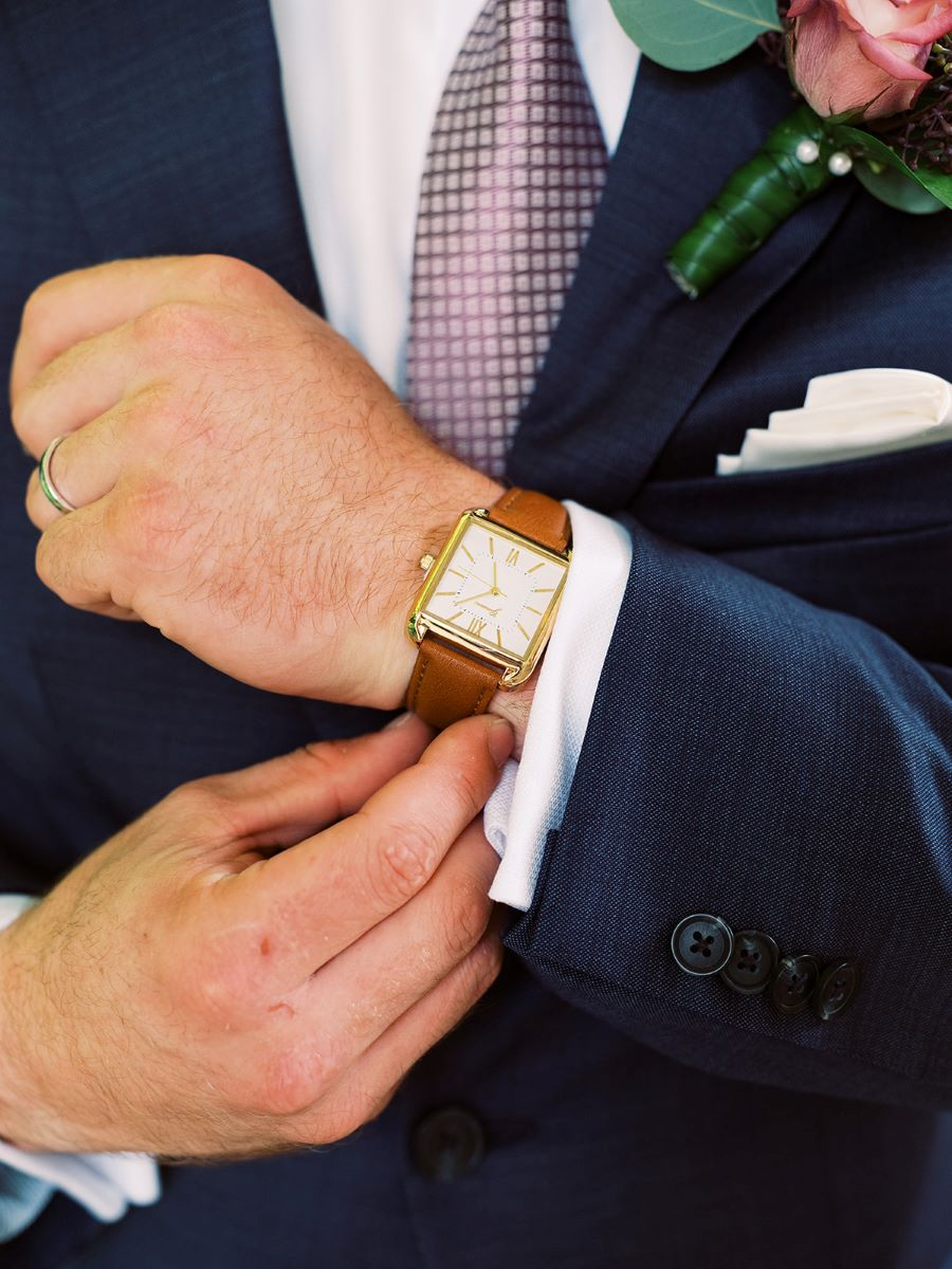 Close up of groom putting on his watch / Elopement / Summer / August