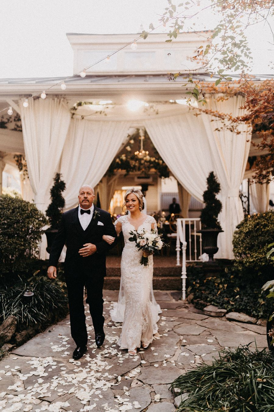 Bride walking down the aisle with her dad / elegant / fall / november / pink / gold / green