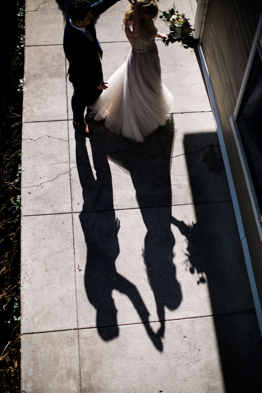 Shadow of groom twirling the bride on the sidewalk / Elopement / Spring / March / Dusty Rose