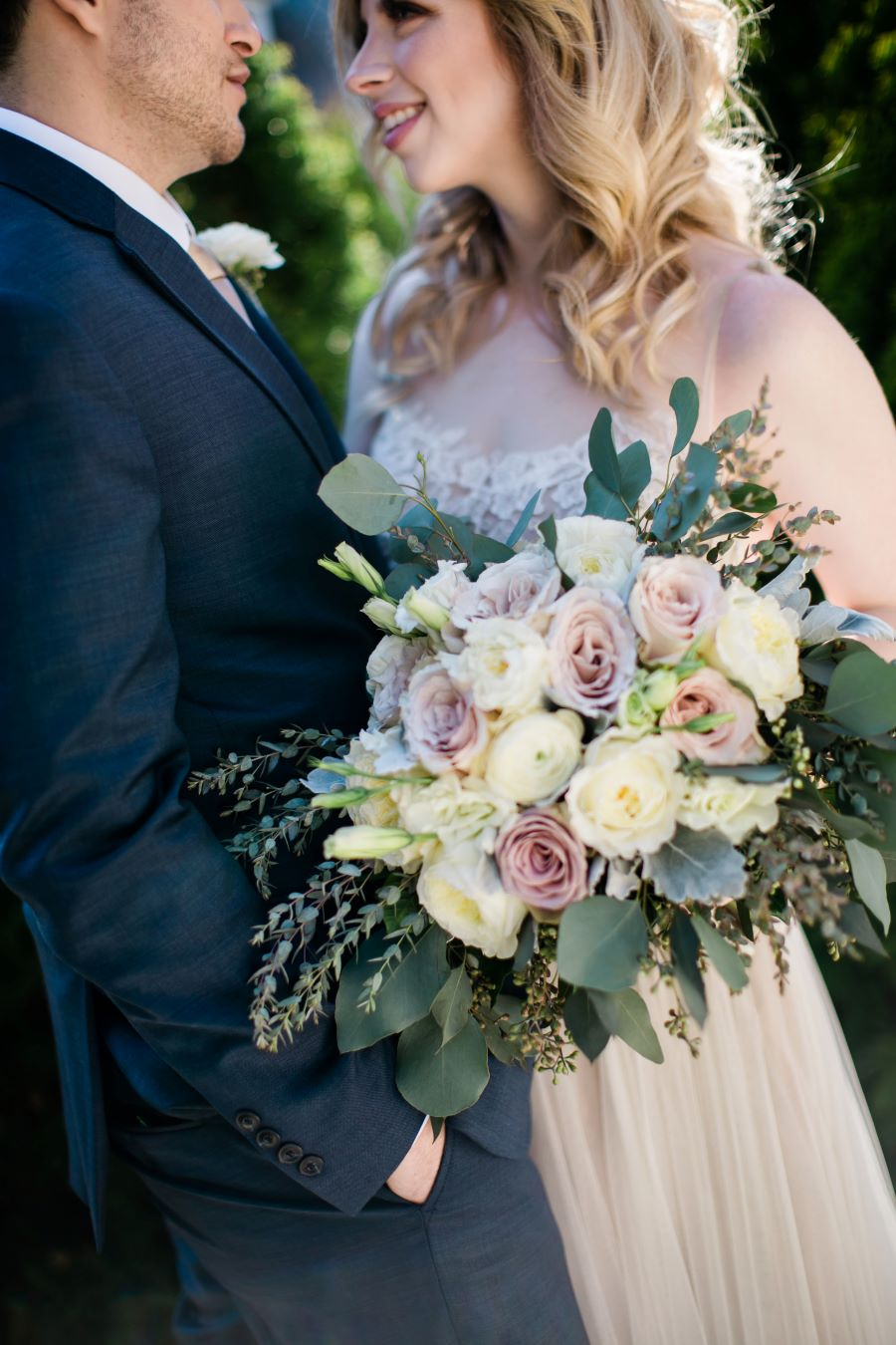 Bride and groom smiling close with bouquet / Elopement / Spring / March / Dusty Rose