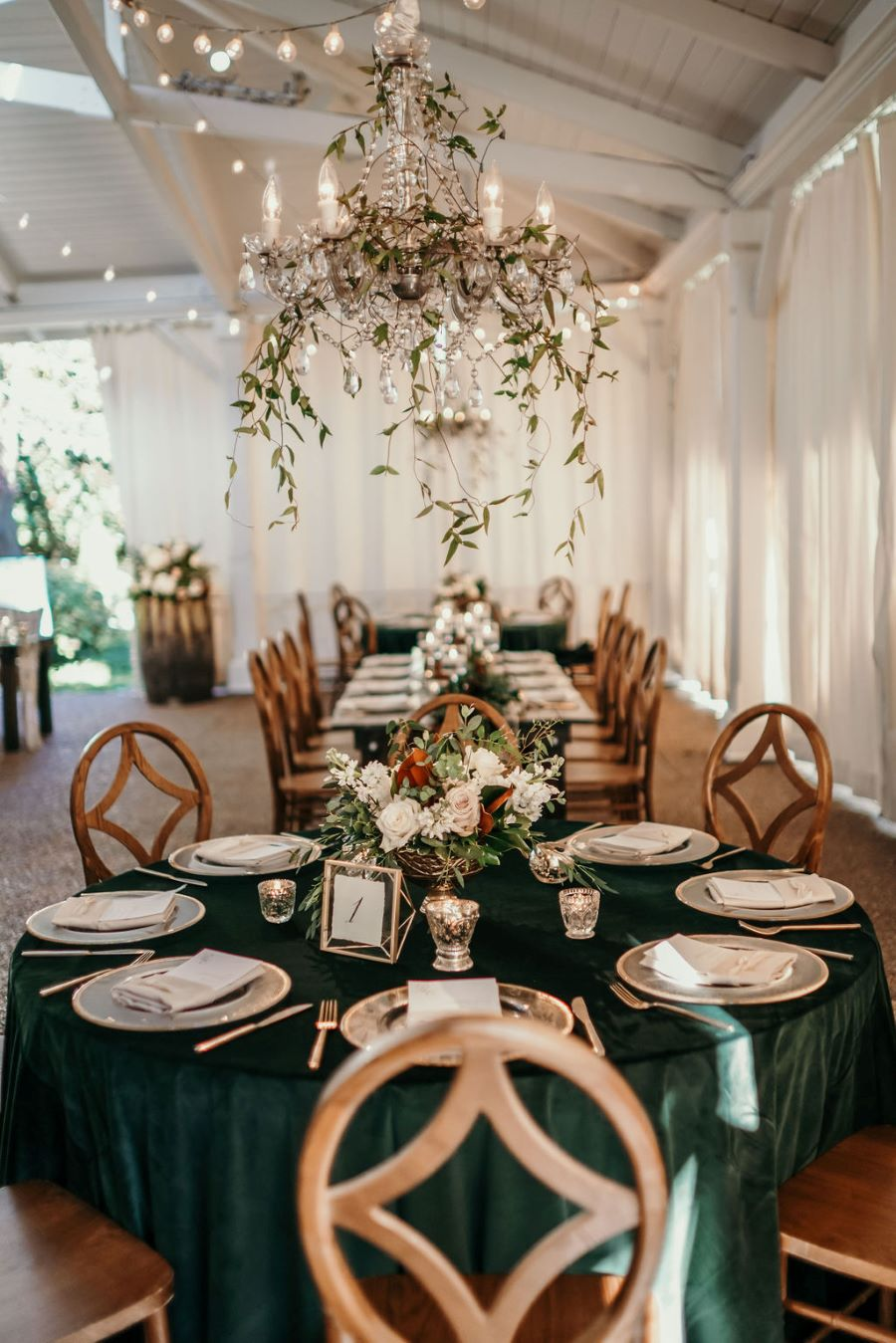 Green velvet linens and mixed tables with greenery chandelier reception / elegant / fall/ green / November