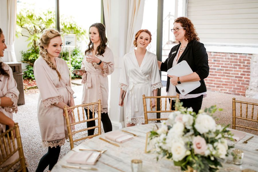 CJ giving bridal party a tour of the reception set up / elegant / spring / April / blush
