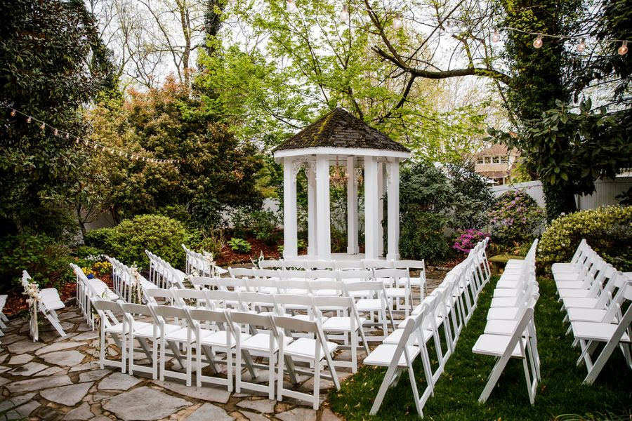 Chairs set up in garden of wedding venue for spring wedding / elegant / spring / April / blush