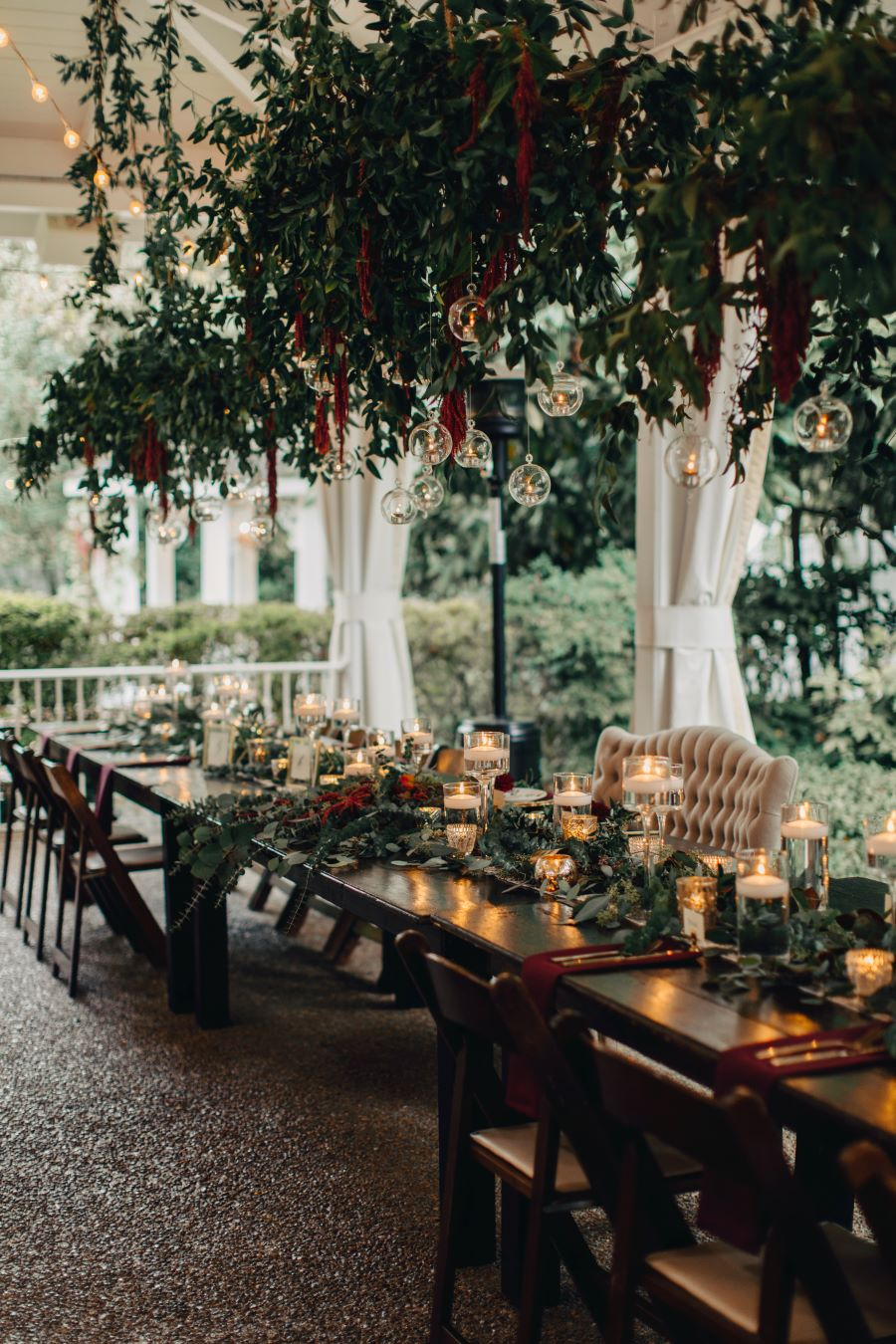 Head table with greenery and hanging lights above / earthy / fall / October / burgundy