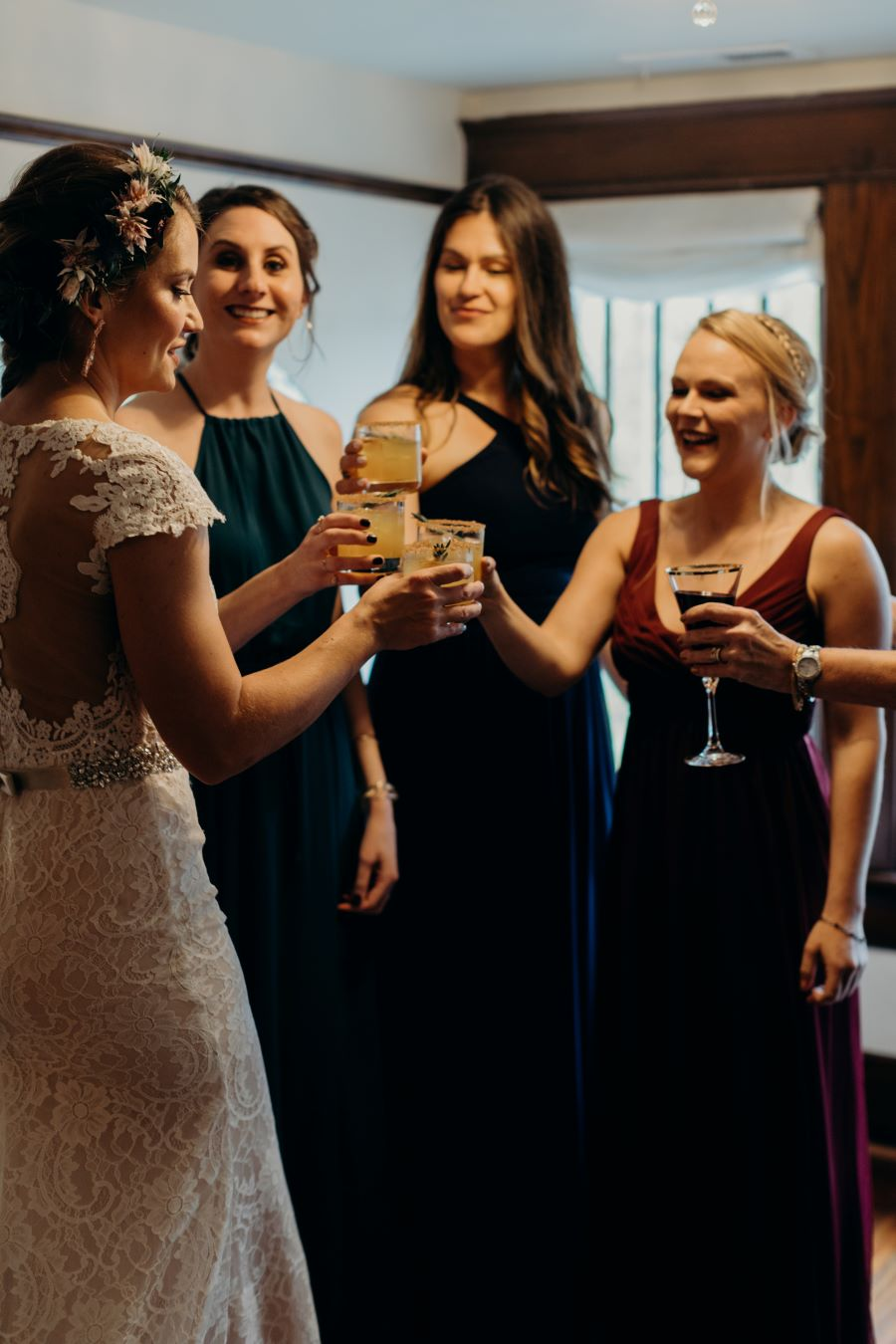 Bridal party cheersing in bridal suite before wedding / earthy / fall / October / burgundy