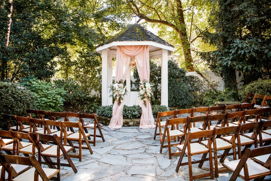 Pagoda with blush drapes and flowers set up in garden of venue / Brunch / Fall / October / Blue / Blush