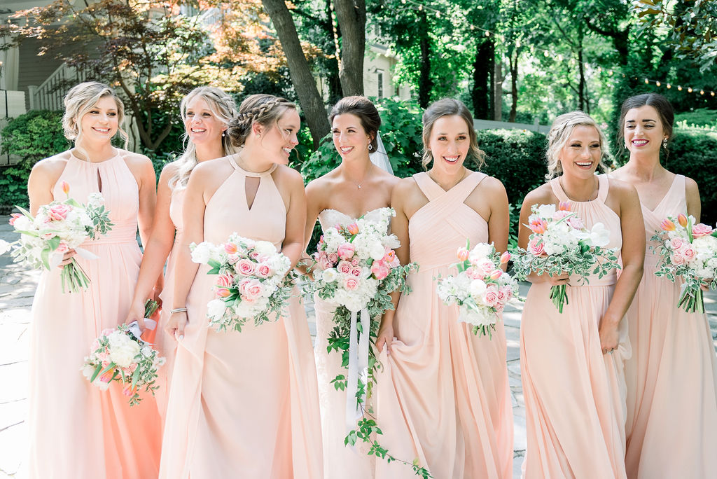 Bridal party in soft pink dresses / Romantic, Fun Spring June Garden Wedding in Pink