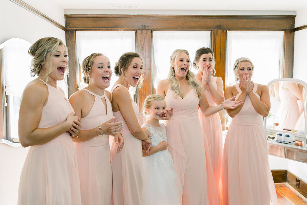Bridal party seeing bride for the first time / Romantic, Fun Spring June Garden Wedding in Pink