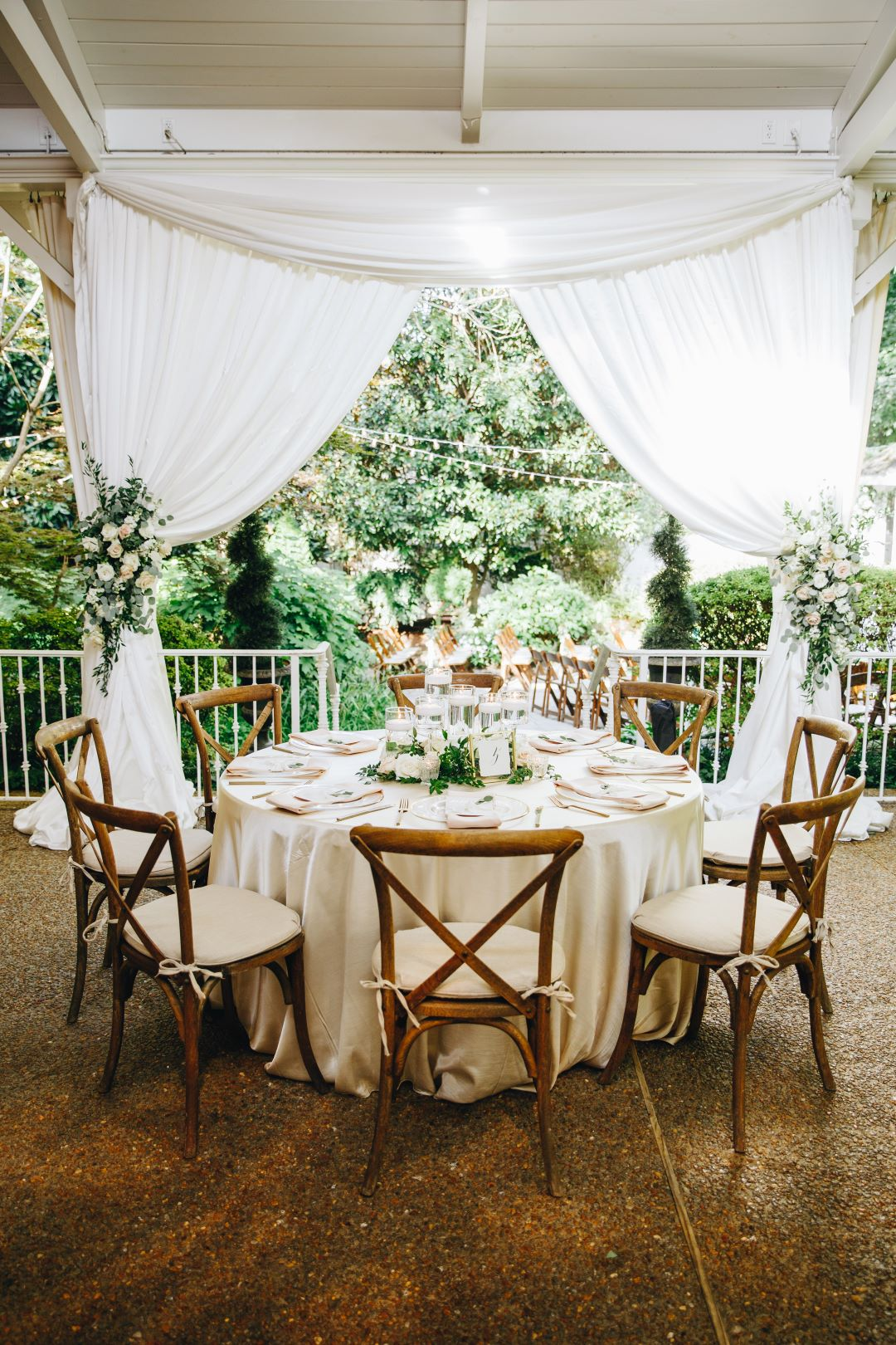 Table setting with rose accents at earthy summer garden wedding in September, neutrals & greenery