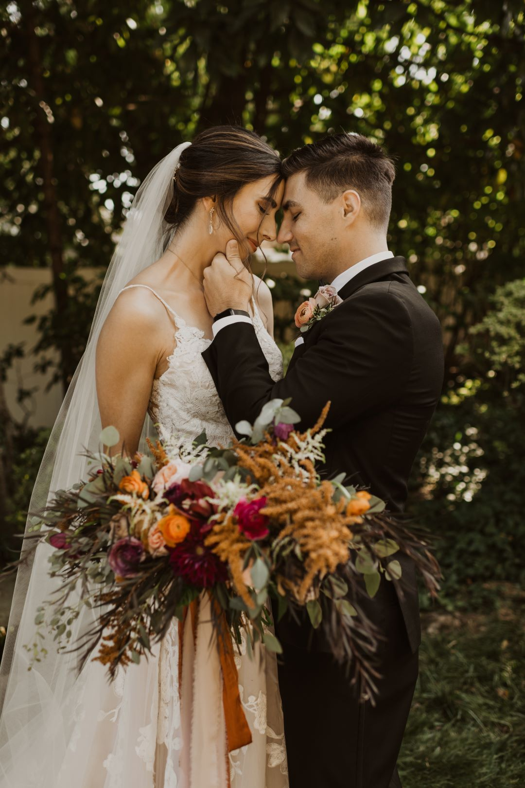 Bride and groom touching foreheads / moody garden wedding, jewel tones, fall, October