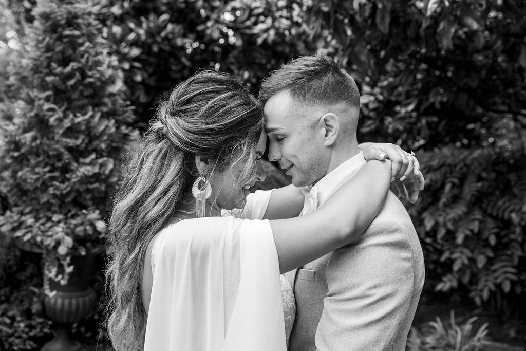 Bride and groom touching foreheads / Boho Chic, Fall, October, Mauve